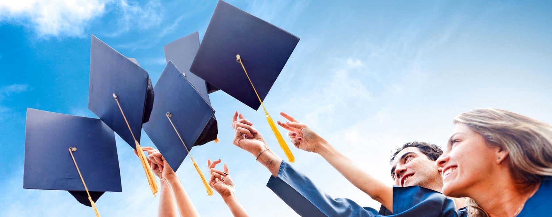 students throwing grad caps