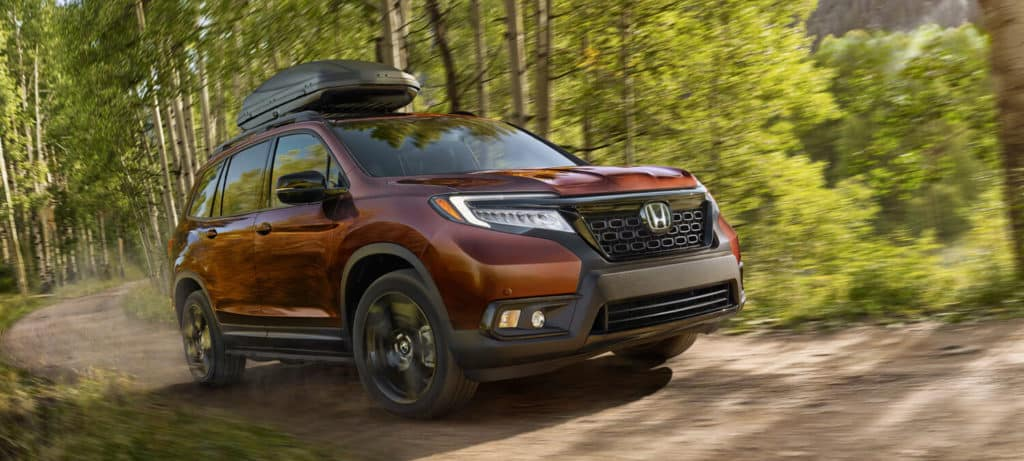 Deep Scarlet Pearl 2020 Honda Passport AWD Exterior Front Angle Forest Location