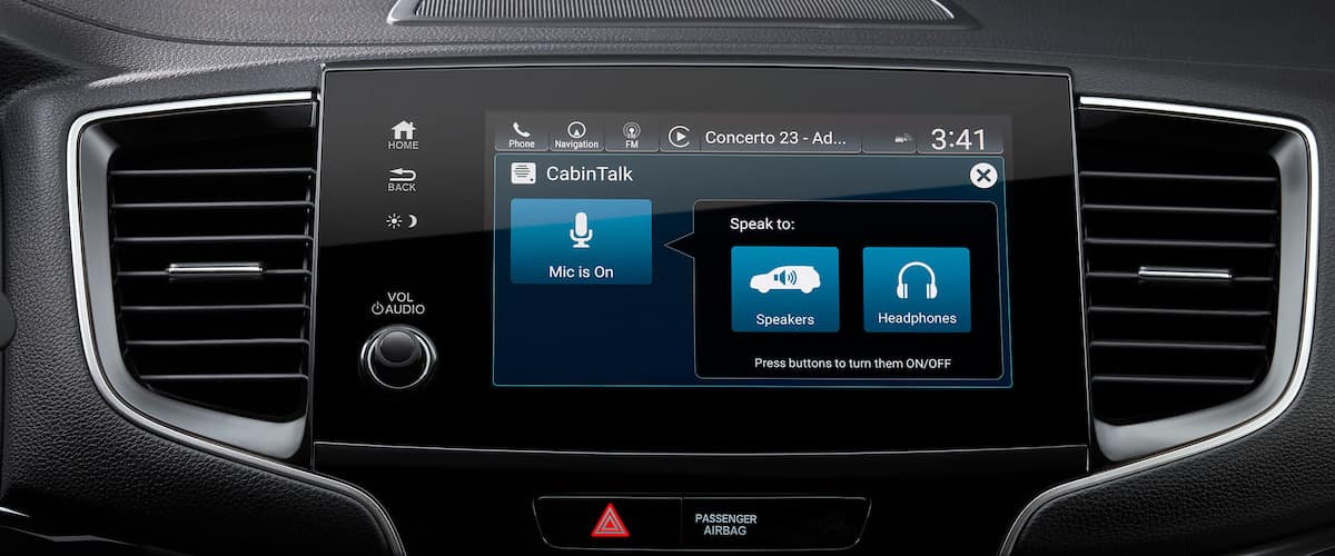 Close on touchscreen with cabin talk feature inside 2021 Honda Pilot