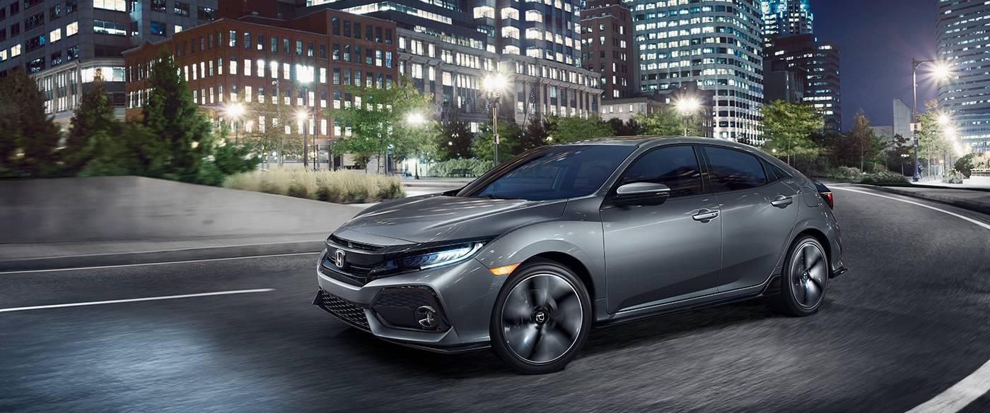 2017 Honda Civic Hatchback driving around a corner