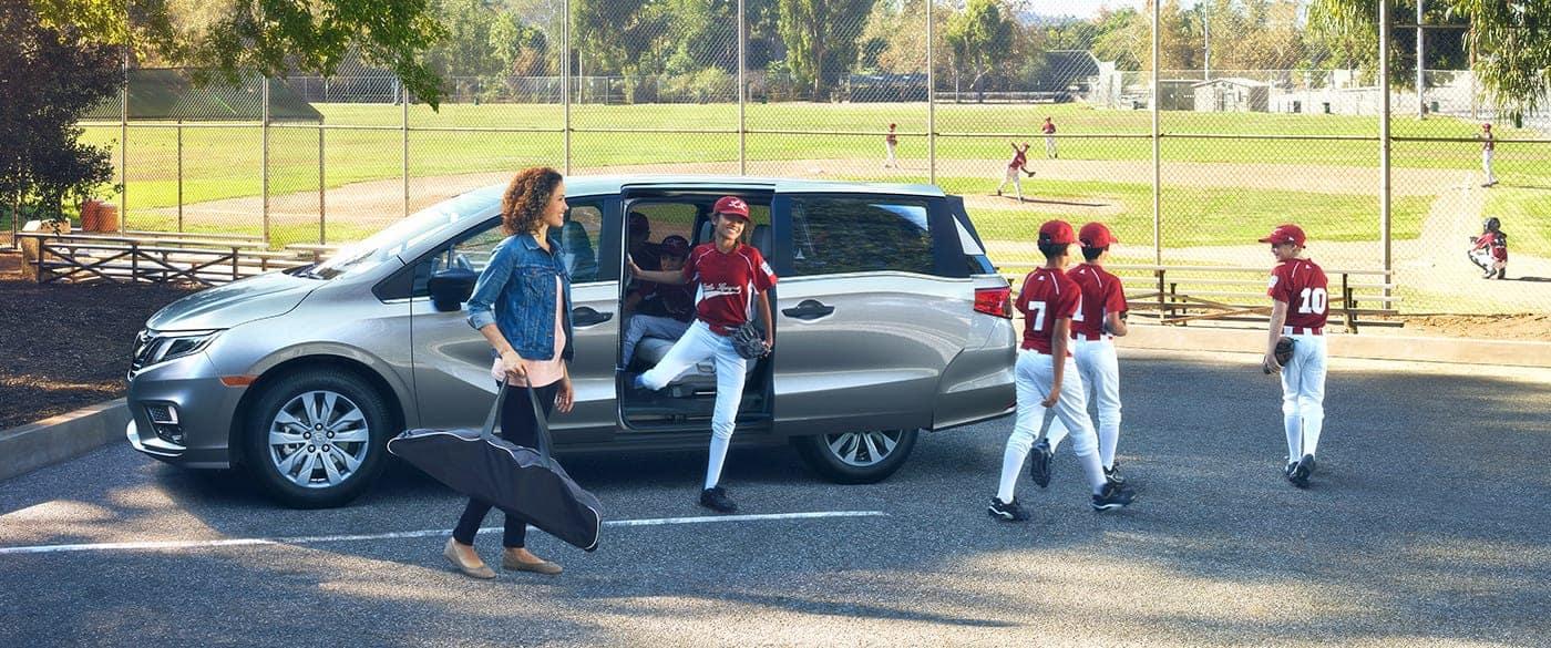 Honda Odyssey parked outside baseball field