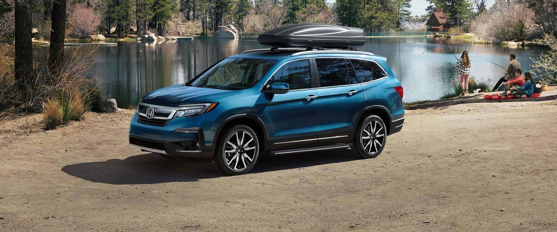 2019 Honda Pilot Parked at Lake with Family Fishing Banner