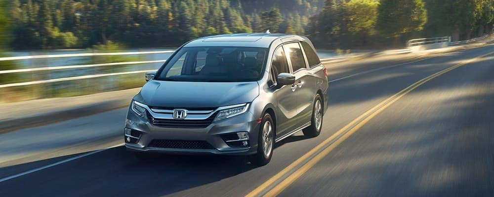 2019 Honda Odyssey driving down the road