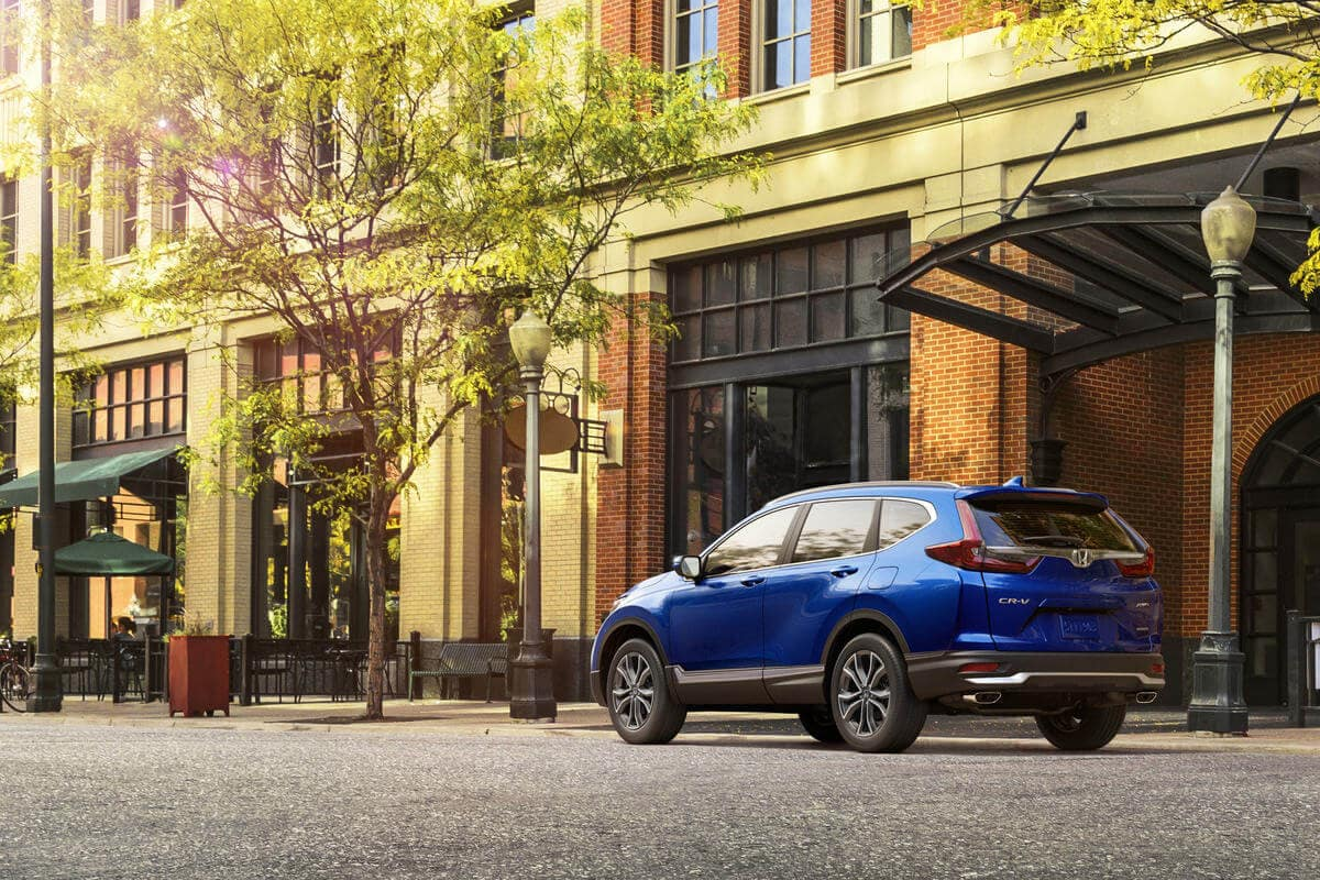 Blue 2020 Honda CR-V parked in front of city buildings