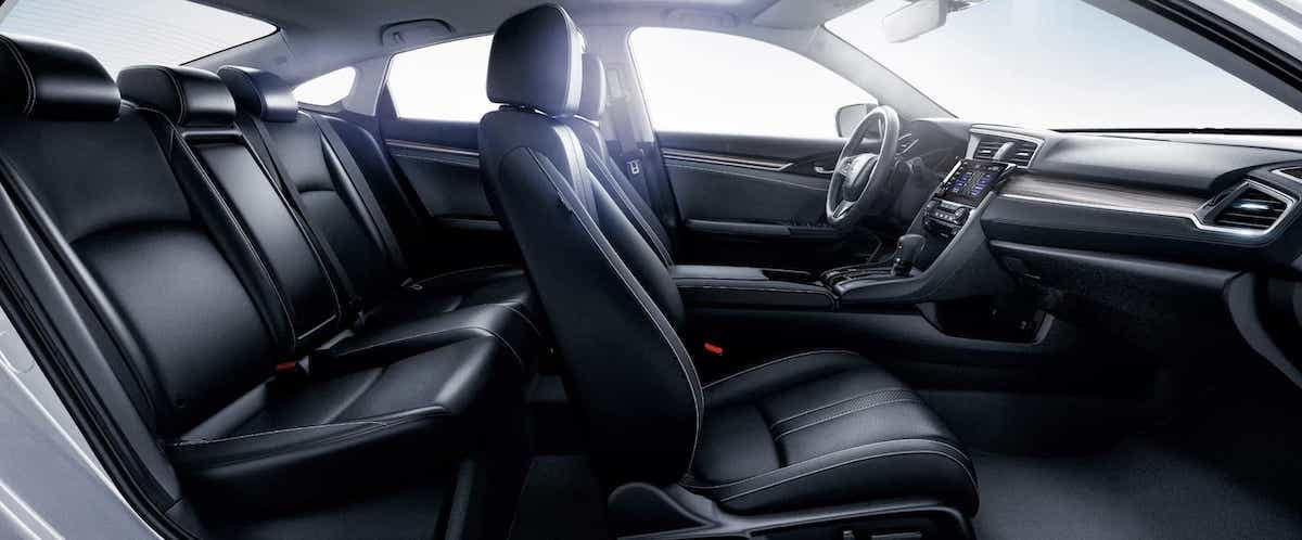 Side view of black leather seats of 2020 Honda Civic Sedan with backlighting