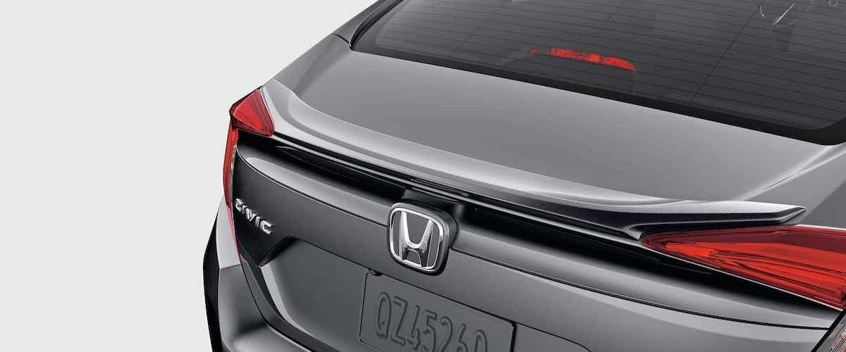 Close on silver decklid spoiler of 2020 Honda Civic Sedan Sport with white background