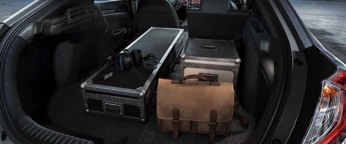 Open trunk of 2020 Honda Civic Hatchback with items inside cargo space