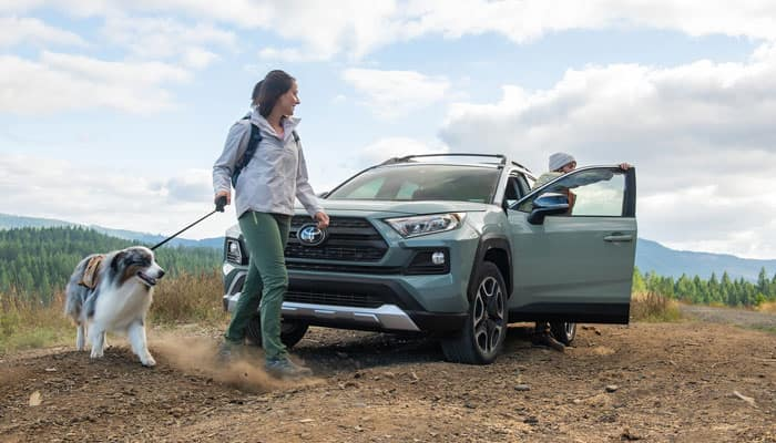 Couple Next to 2019 Toyota RAV4
