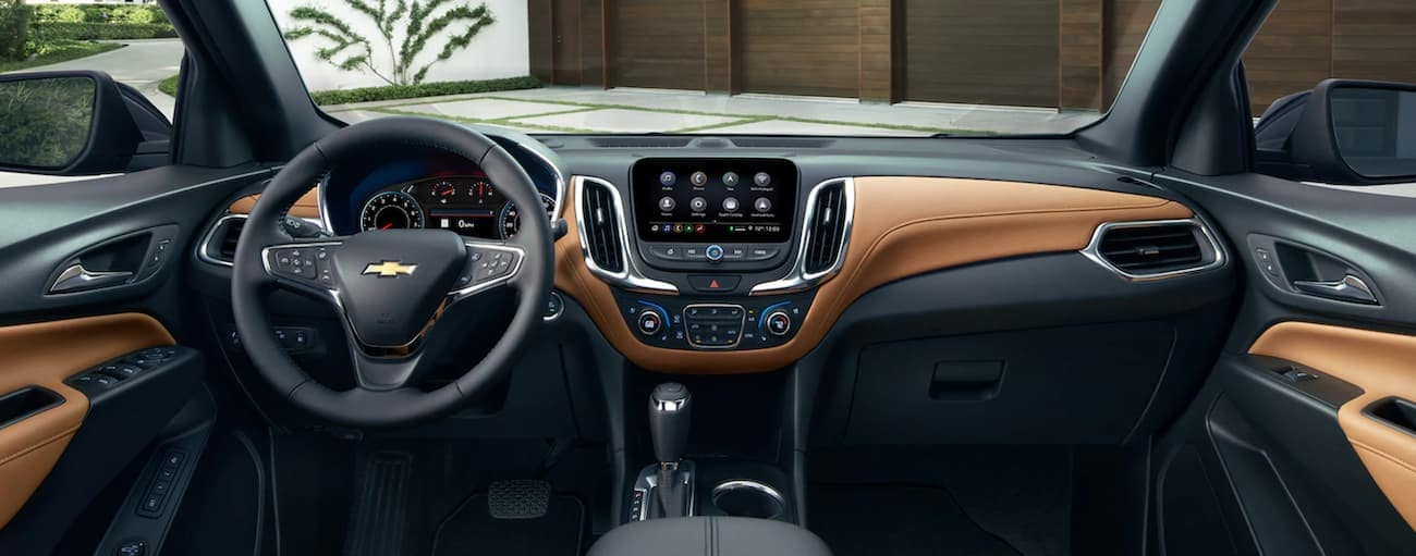 The black and tan interior of a 2021 Chevy Equinox is shown.