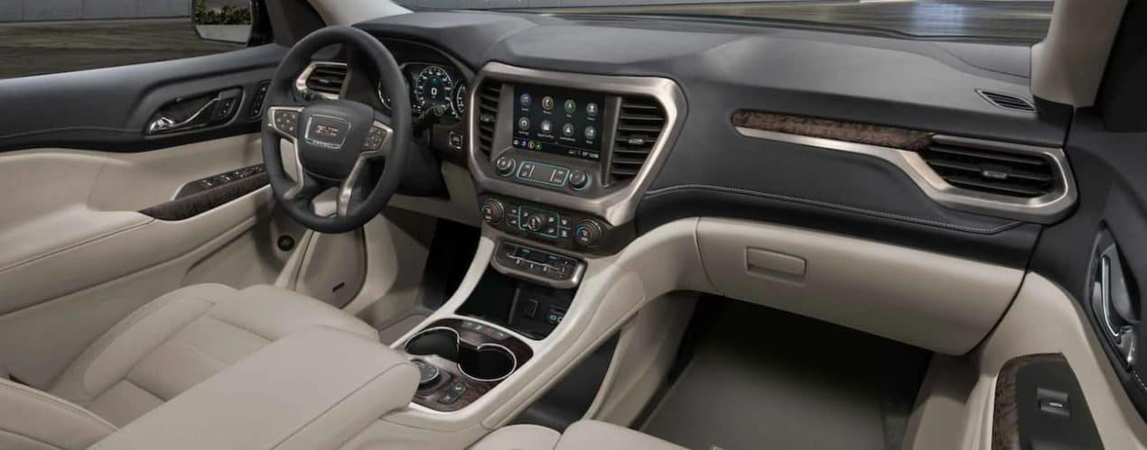 The white and black interior of a 2021 GMC Acadia is shown.