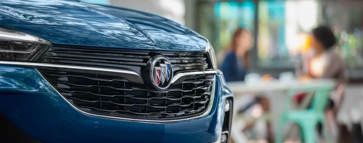 A close up shows the grille and Buick emblem on a blue 2021 Buick Encore GX.