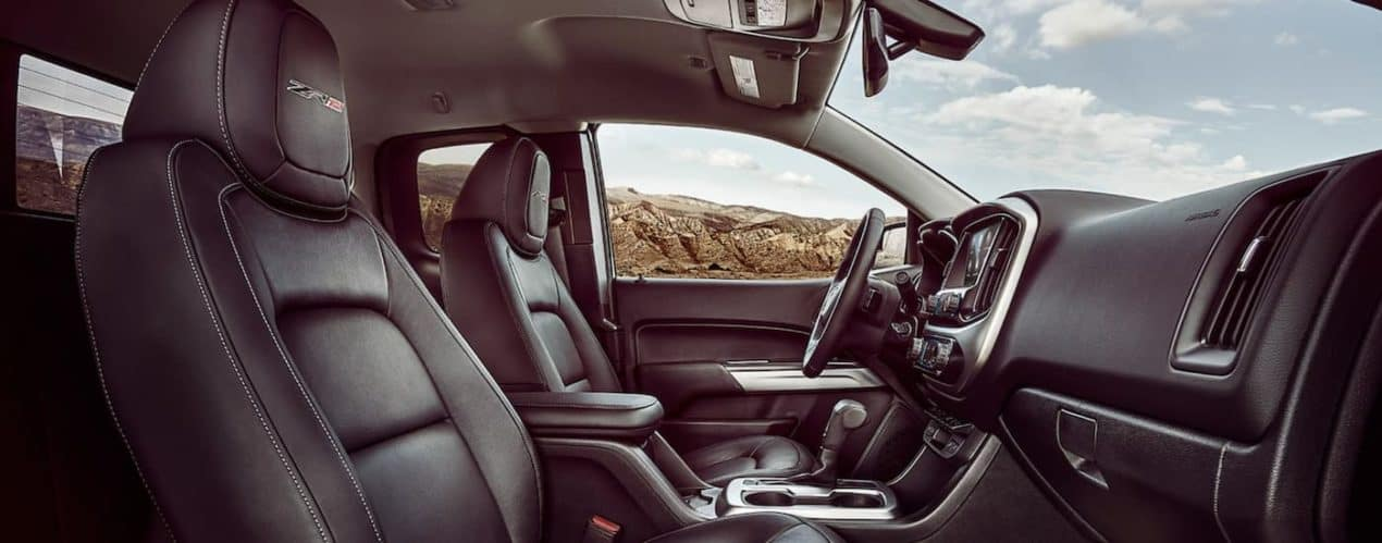 The front seats and dash are shown from the passenger side on a 2021 Chevy Colorado.