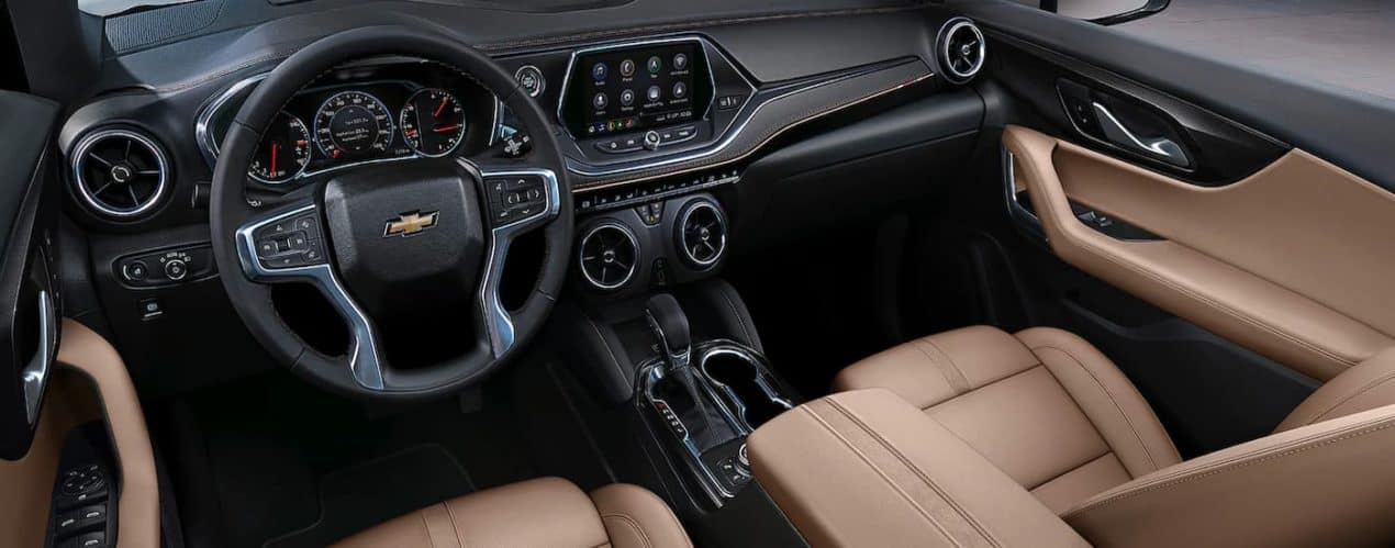 The tan seats and black dash are shown in a 2021 Chevy Blazer.