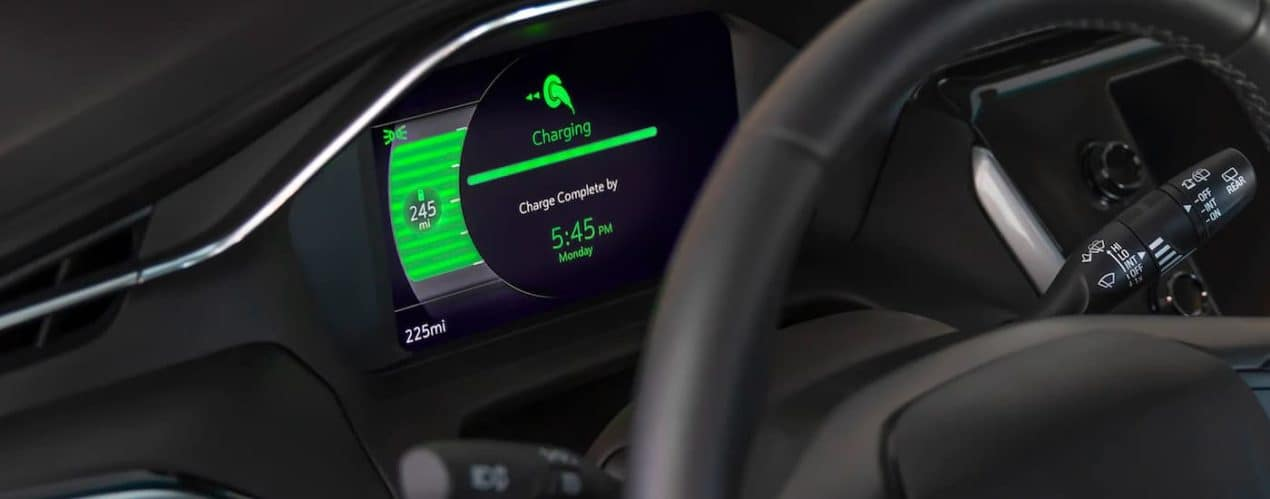 A close up shows the gauge cluster and charging progress in a 2022 Chevy Bolt EUV.