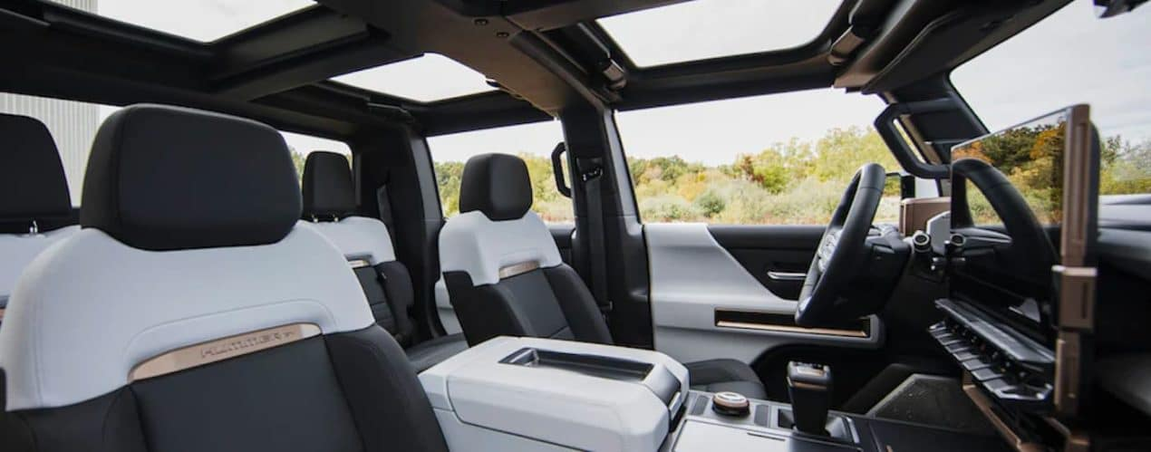 The white and black interior is shown in a 2022 GMC Hummer EV truck.