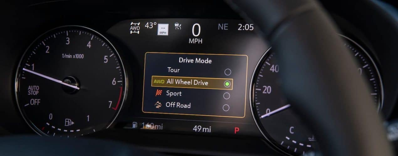 A close up shows the gauge with drive modes in a 2021 Buick Envision Avenir.