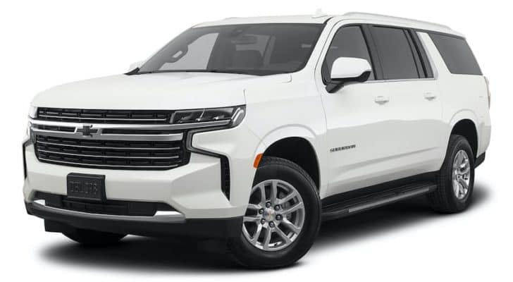 A white 2021 Chevy Suburban LT is angled left.