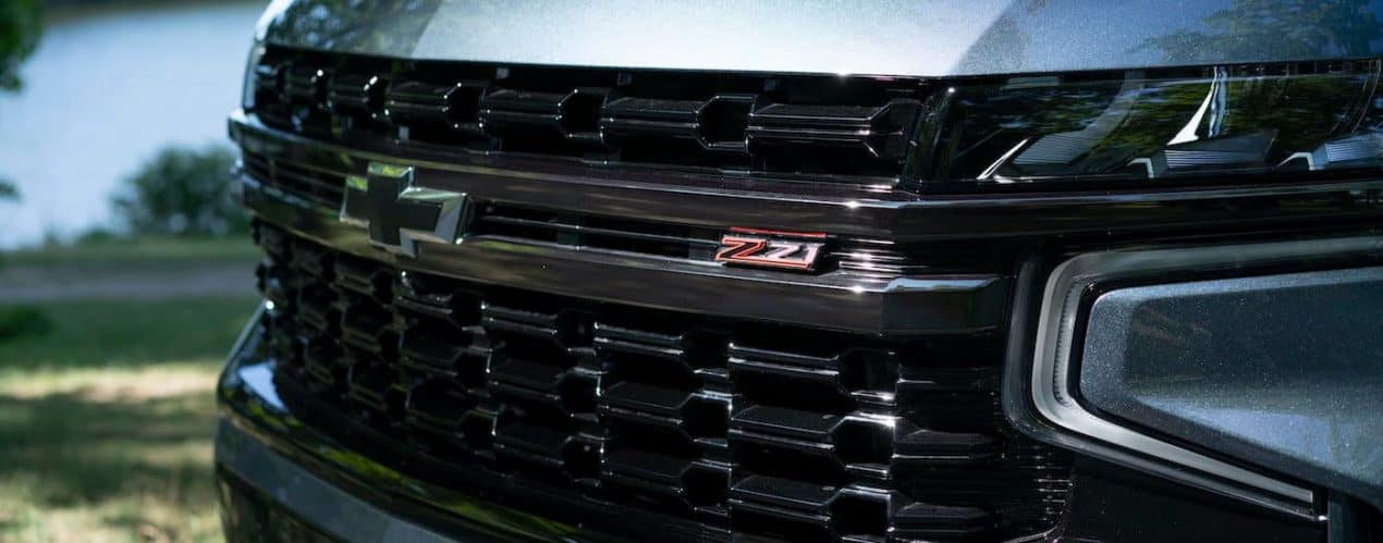 A close up shows the front grille and badging on a blue 2021 Chevy Suburban Z71.