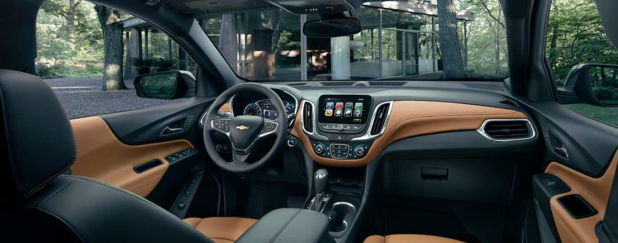 The front seats and dash are show in a 2021 Chevy Equinox.