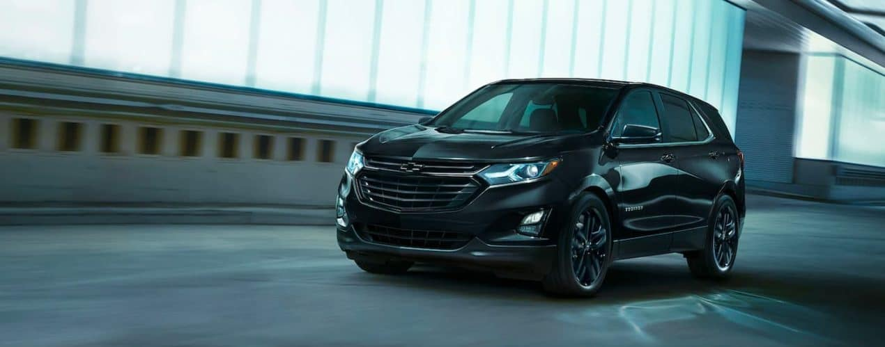 A black 2021 Chevy Equinox Midnight Edition is shown driving through a tunnel after winning the 2021 Chevy Equinox vs 2021 Toyota RAV4 comparison.