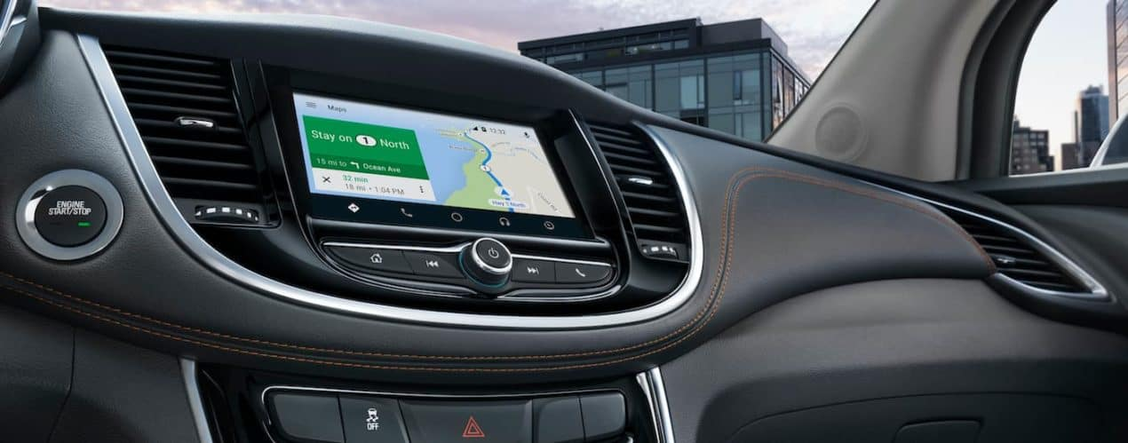 The infotainment screen is shown with navigation in a 2021 Chevy Trax.