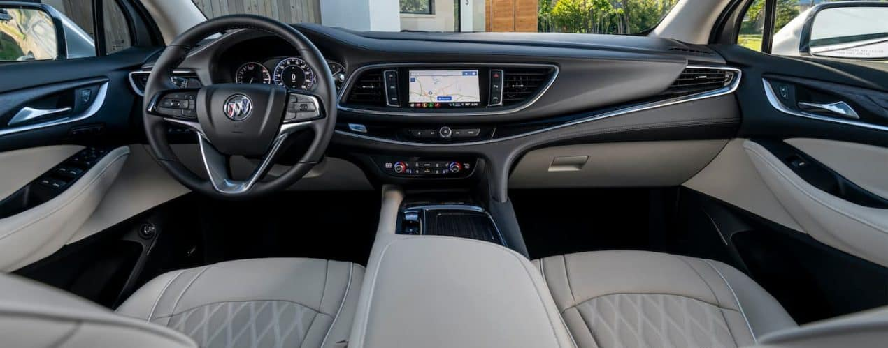 The black and grey interior is shown in a 2022 Buick Enclave Avenir.
