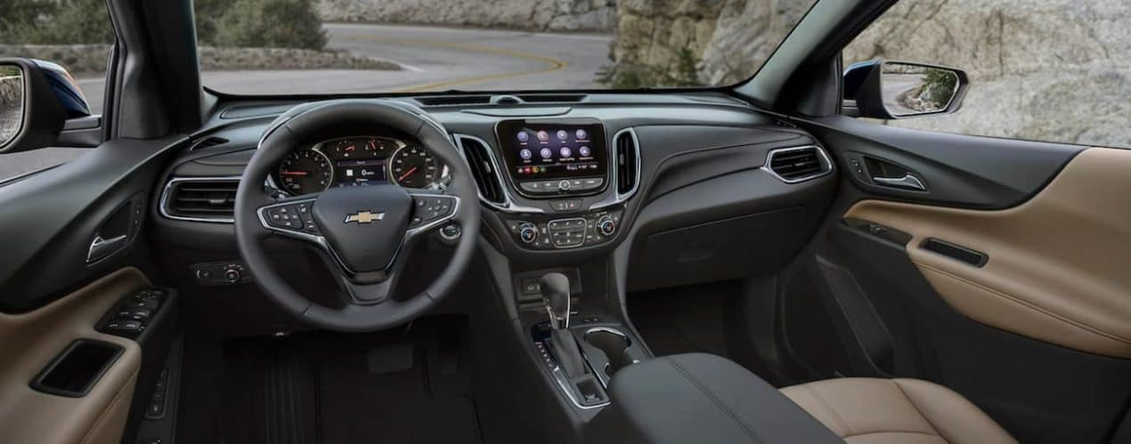 The interior of a 2022 Chevy Equinox shows the steering wheel and infotainment screen.