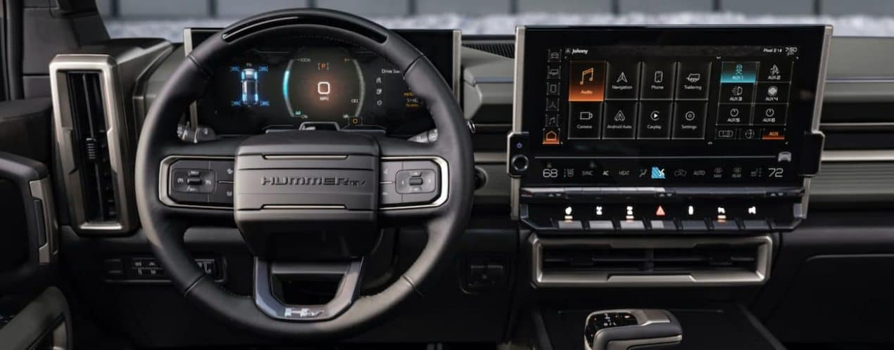 The infotainment screens and wheel are shown in a 2023 GMC Hummer EV SUV.