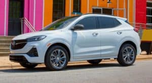 A white 2022 Buick Encore GX is shown parked on a city street.