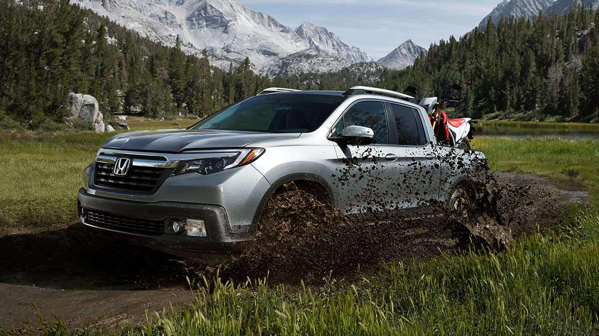 2017 Honda Ridgeline in front of snowy mountains