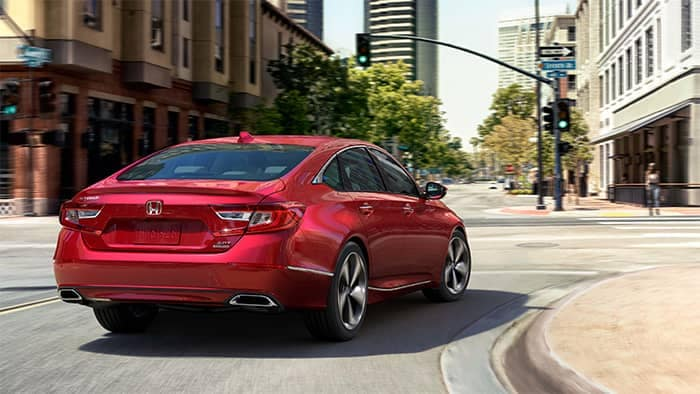 Honda Accord Turning a Corner in the City