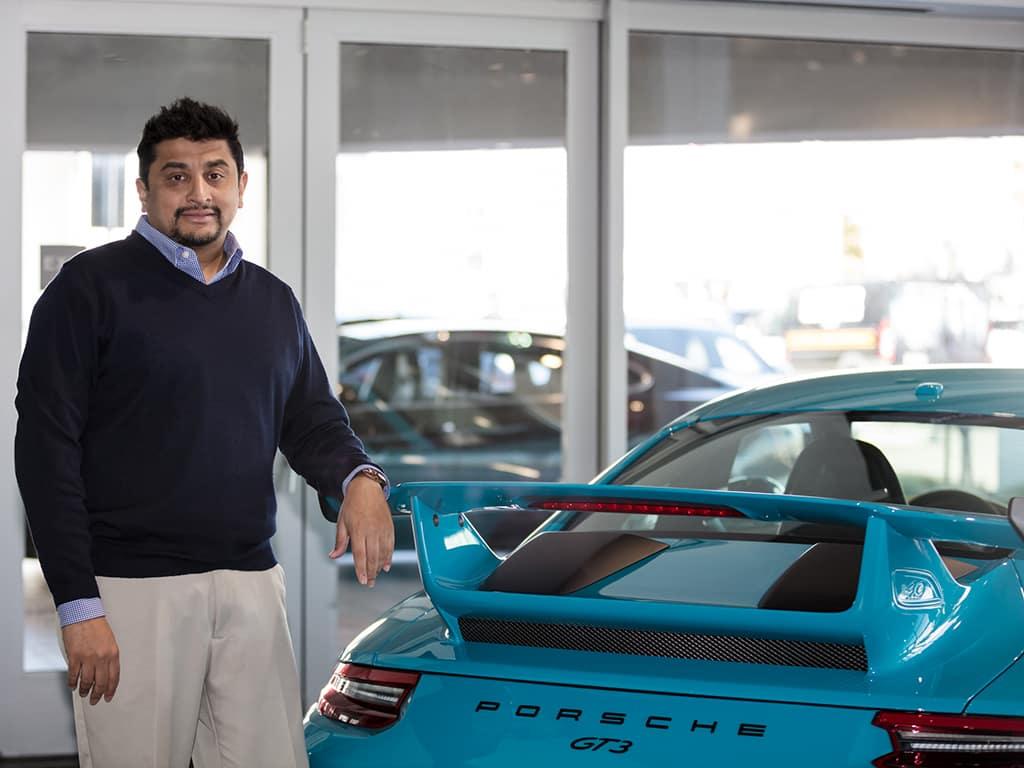 "Viraj ""Raj"" Kumar Porsche Fremont 911 GT3 Miami Blue"