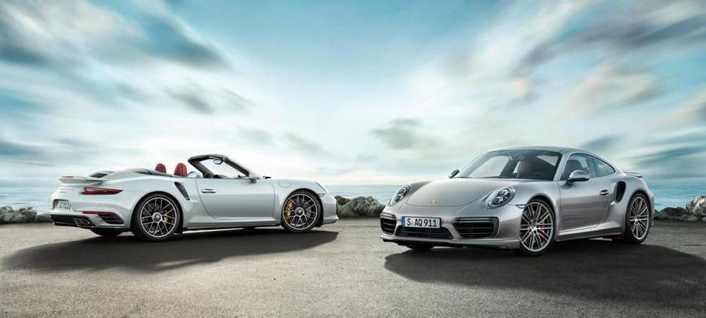 Two 2018 Porsche 911 Models under wide open sky