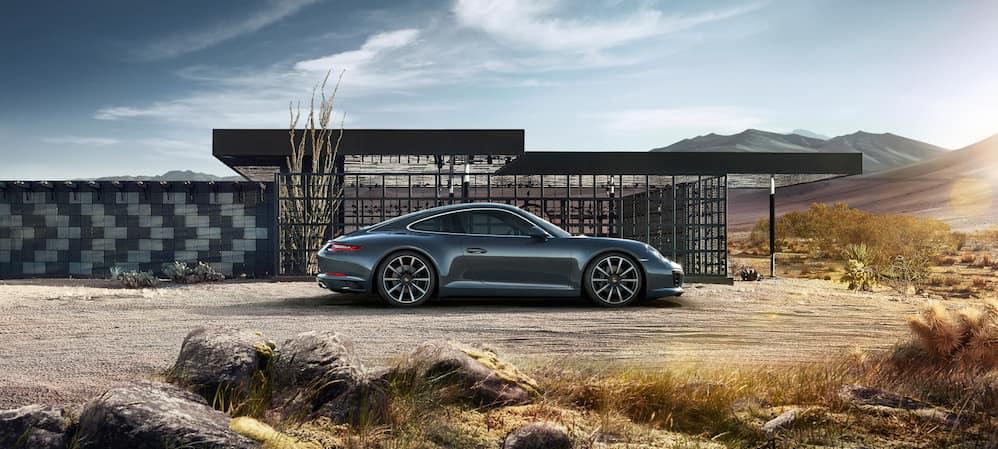 Blue Porsche 911 in desert
