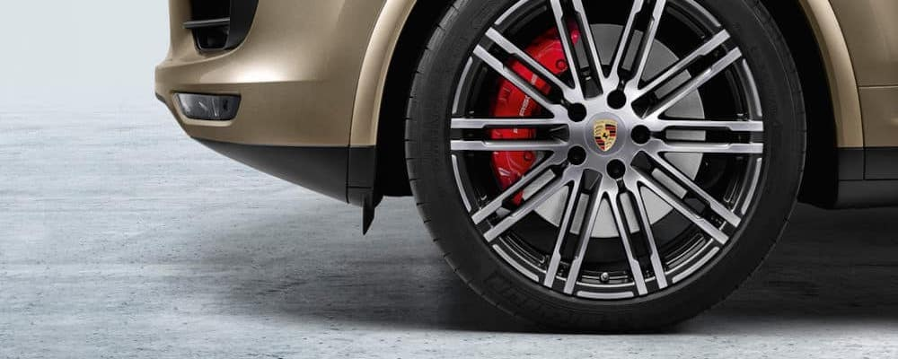 Closeup of a Porsche vehicle's wheel and tire