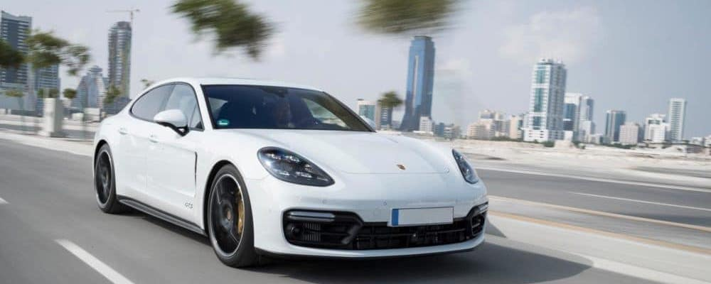 White Porsche on the road