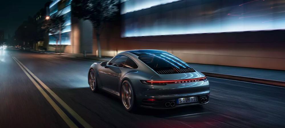 2019 Porsche 911 Carrera S driving down a city street at night