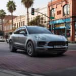 2019 Porsche Macan driving through a city intersection