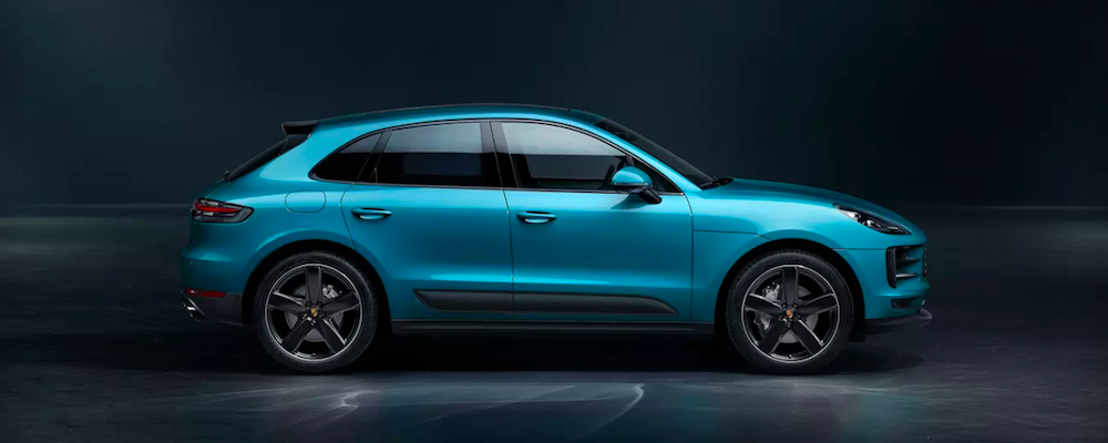 Parked Porsche Macan in Miami Blue, one of the many Porsche Macan colors
