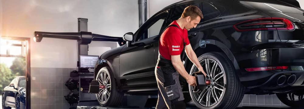 Technician servicing a Porsche Macan
