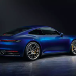 Blue 2019 Porsche 911 Carrera S parked in dark room