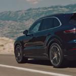 Porsche Cayenne cruising down highway in the desert