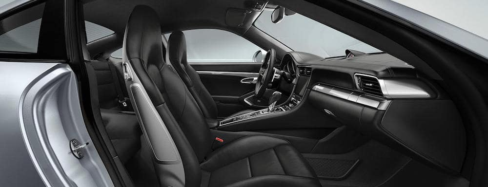 Looking inside Porsche 911 cabin via passenger door