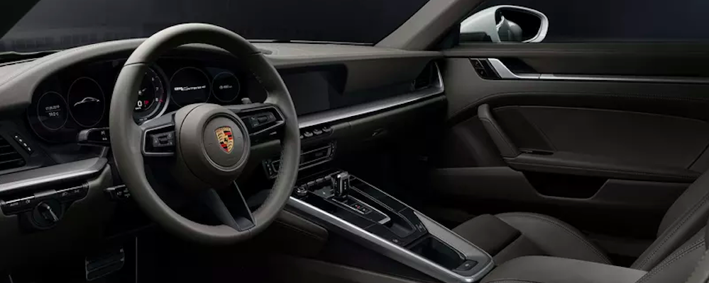 View of Porsche 911 from seats from driver side door