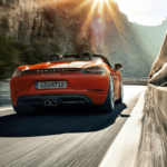 2020 Porsche 718 Boxster driving down the road
