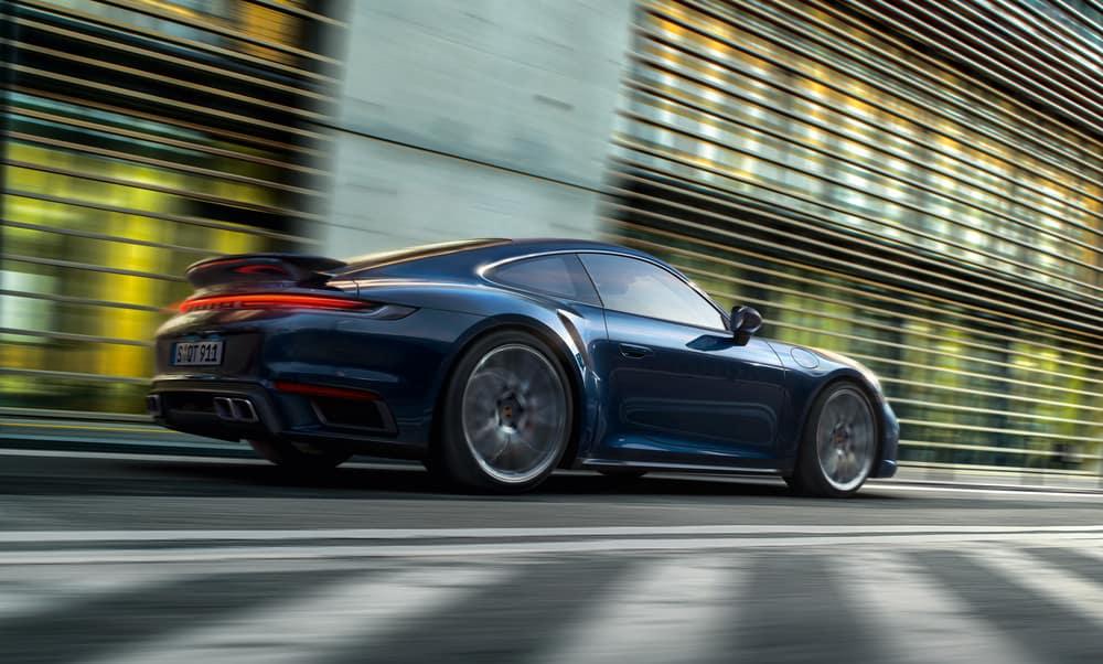 2021 Porsche 911 Turbo driving down road