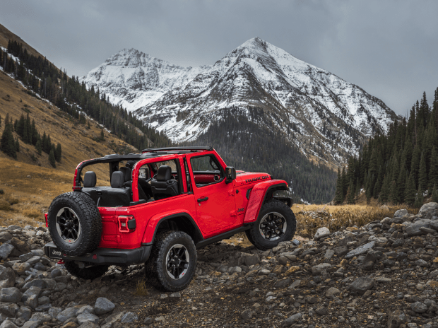Red Jeep Wrangler in Mountains