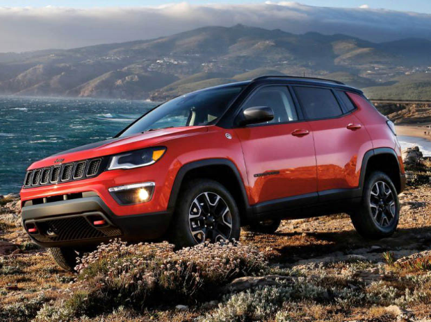 Red jeep Compass on mountain