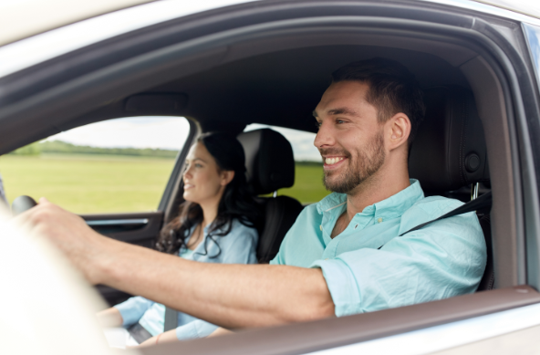 two people in car smiling