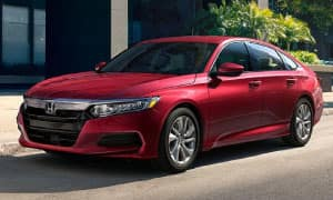A red 2019 Honda Accord in an upscale driveway